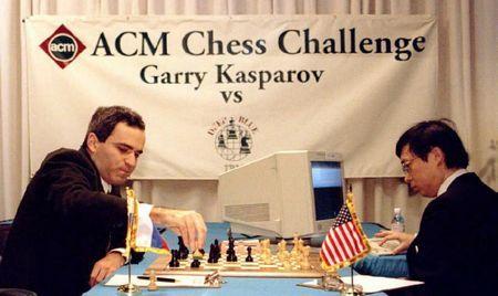 World chess champion Garry Kasparov, L, takes a pa