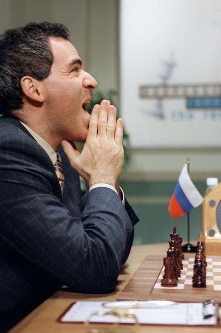 World Chess champion Garry Kasparov holds his hand